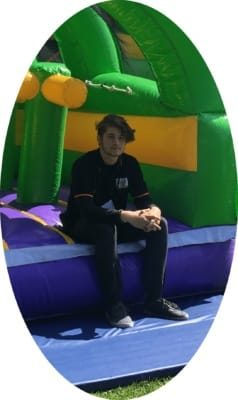 supervisor / installer standing in front of a jumping castle